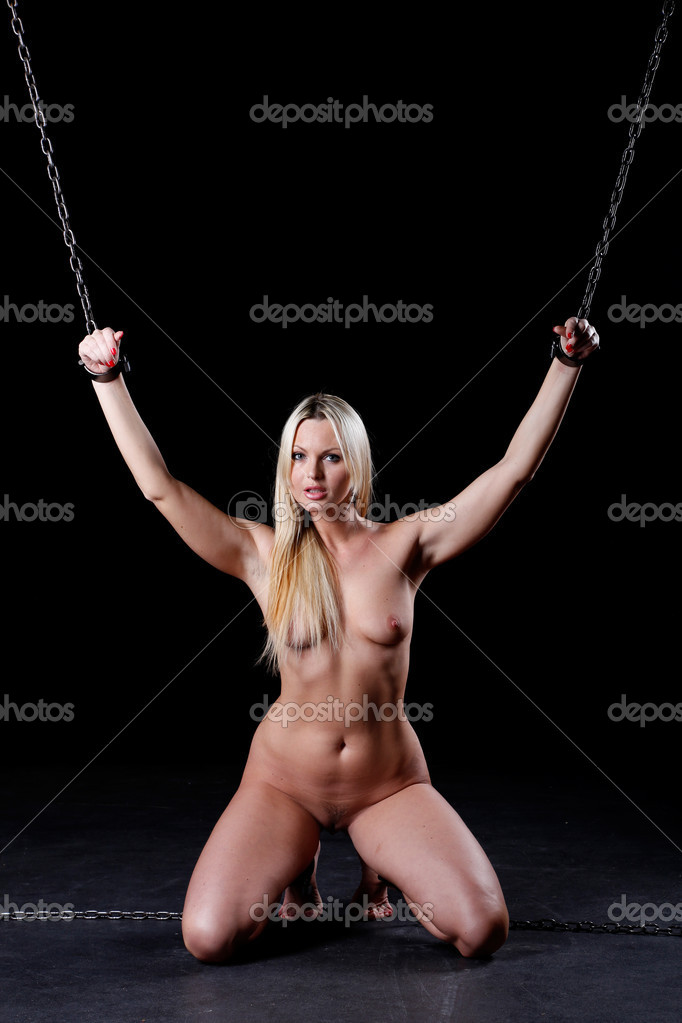 Nude female bondage