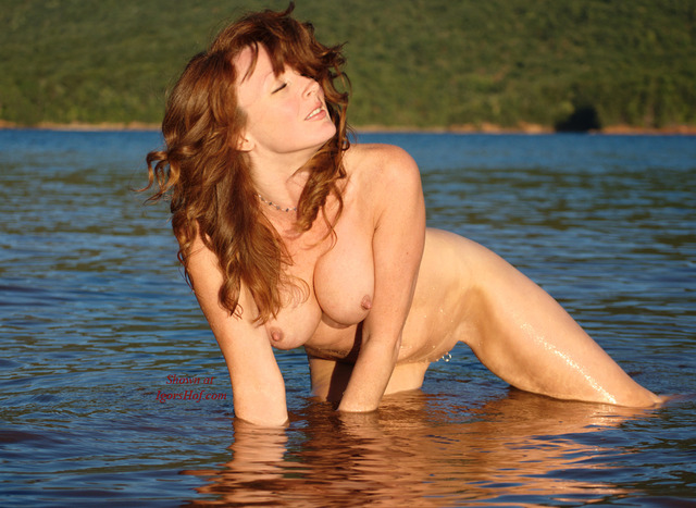 naked red haired pussy pics redhead naked sun afternoon water kneeling