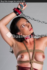 athletic nude pics athletic nude brunette bound ropes chains buy stock photo
