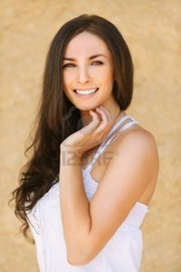 brunette woman pics zigf portrait young beautiful smiling brunette woman wearing white dress against yellow background photo