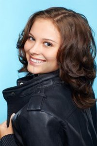 brunette woman pics sergeyp portrait beautiful young brunette woman black leather jacket blue photo