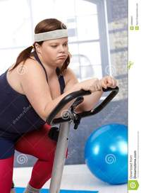 free fat woman pics exhausted fat woman exercise bike royalty free stock photography