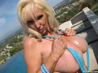 mature porn pics tits porn mature whore sunning silicone pumped breasts photo