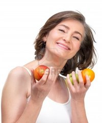 naked mature females logos mature woman holding fruit against white background photo