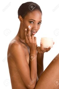 nude pictures of young ladies mocker beautiful nude young african american woman slicked back hair applying moisturizer face stock photo