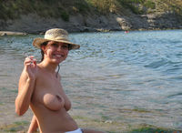 nudist big tits pics smiling brunette very boobs posing topless public beach