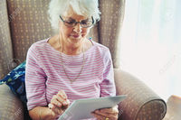 old mature women pictures warrengoldswain mature woman concentrating digital tablet stock photo only old women
