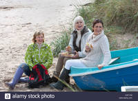 old mature women pictures comp cxp group mature women enjoying picnic sitting old boat stock photo