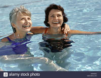 photo of mature women comp awrw mature women swimming pool smiling stock photo