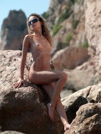 pic of naked black woman fotoluxstudio beautiful naked woman sits rock black sea coast crimea ukraine photo