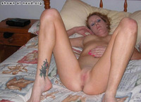 pictures of a shaved vagina naked redhead shaved pussy bed