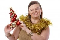 plump woman pics nyul christmas portrait happy plump woman holding small tree smiling photo