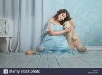 plump woman pics comp tgd plump woman sitting floor room gently hugging bear stock photo