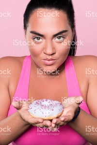 plump woman pics photos portrait beautiful plump woman holding tasty dessert picture photo