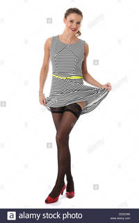 stocking sexy picture comp model released sexy young woman raising skirt showing stocking tops stock photo